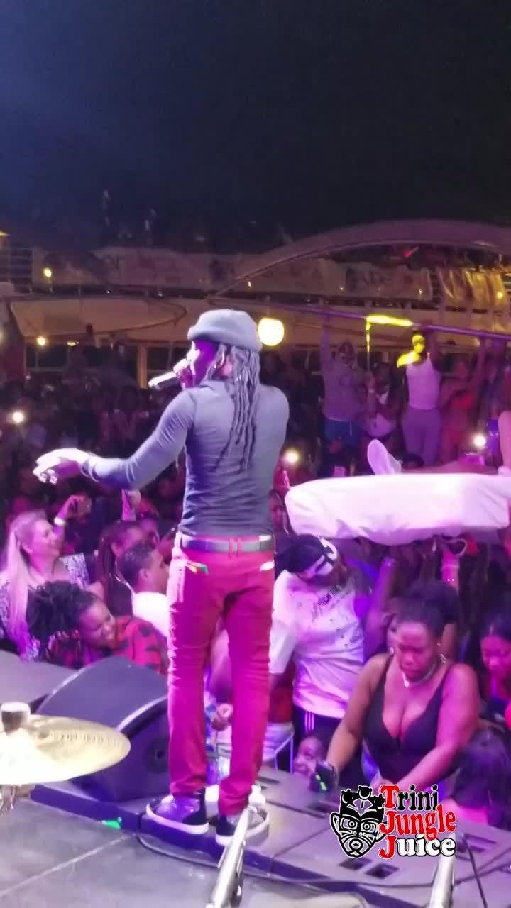 Grenada artiste Mr. Killa crowd surfs on a bed.mp4
